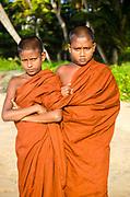 Young monks posing on Matara beach, Sri Lanka