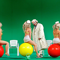 Picture shows : Adrian Powter as Taddeo with bunny girls...Picture  ©  Drew Farrell Tel : 07721 -735041..A new Scottish Opera production of  Rossini?s 'The Italian Girl in Algiers' opens at The Theatre Royal Glasgow on Wednesday 21st October 2009..(Soap) opera as you've never seen it before.Tonight on Algiers?..Colin McColl?s cheeky take on Rossini?s comic opera is a riot of bunny girls, beach balls, and small screen heroes with big screen egos. Set in a TV studio during the filming of popular Latino soap, Algiers, the show pits Rossini?s typically playful and lyrical music against the shoreline shenanigans of cast and crew. You?d think the scandal would be confined to the outrageous storylines, but there?s as much action off set as there is on?. .Italian bass Tiziano Bracci makes his UK debut in the role of Mustafa. Scottish mezzo-soprano Karen Cargill, who the Guardian called a ?bright star? for her performance as Rosina in Scottish Opera?s 2007 production of The Barber of Seville, sings Isabella. .Cast .Mustafa...Tiziano Bracci.Isabella..Karen Cargill.Lindoro...Thomas Walker.Elvira...Mary O?Sullivan.Zulma...Julia Riley.Haly...Paul Carey Jones.Taddeo...Adrian Powter. .Conductors.Wyn Davies.Derek Clarke (Nov 14). .Director by Colin McColl.Set and Lighting Designer by Tony Rabbit.Costume Designer by Nic Smillie..New co-production with New Zealand Opera.Production supported by.The Scottish Opera Syndicate.Sung in Italian with English supertitles..Performances.Theatre Royal, Glasgow - October 21, 25,29,31..Eden Court, Inverness - November 7. .His Majesty?s Theatre, Aberdeen  - November 14..Festival Theatre,Edinburgh - November 21, 25, 27 ...Note to Editors:  This image is free to be used editorially in the promotion of Scottish Opera. Without prejudice ALL other licences without prior consent will be deemed a breach of copyright under the 1988. Copyright Design and Patents Act  and will be subject to payment or legal action, where appropriate..Further further informat