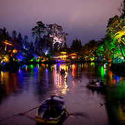 Rowing boats on the lake during the Festival of Lights  at Pukekura Park. New Plymouth, New Zealand, 19th December  2010 Photo Tim Clayton..
