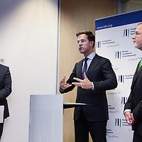 Nederland, Amsterdam , 15 mei 2014. <br /> Minister-president Rutte (m) opende donderdag 15 mei de Nederlandse vestiging van de Europese Investeringsbank (EIB) in Amsterdam. <br /> Pim van Ballekom, vice-president (l)  en rechts Werner Hoyer, de president van de EIB.De EIB is het financieringsinstituut van de Europese Unie.<br /> De 28 lidstaten zijn aandeelhouder. De bank is opgericht in 1958 bij het Verdrag van Rome en heeft als doel projecten te financieren die zijn gericht op de versterking van de Europese economie.<br /> <br /> Prime Minister Rutte (m) opened Thursday, May 15th, the Dutch branch of the European Investment Bank (EIB) in Amsterdam. Left Pim van Ballekom, Vice-President of the EIB and right Werner Hoyer, president.<br /> <br /> The EIB is the financing institution of the European Union.