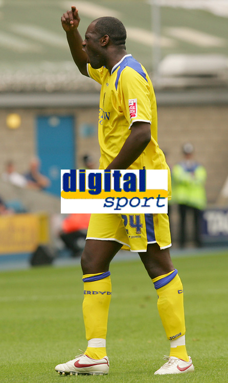 Photo: Frances Leader.<br />Millwall v Cardiff City. Coca Cola Championship.<br />24/09/2005.<br /><br />Cardiff's Michael Ricketts swears at the lines man and gets a warning from the ref