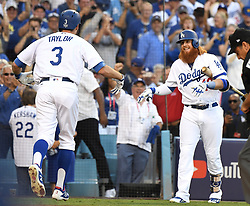October 24, 2017 - Los Angeles, California, U.S. - Los Angeles Dodgers' Chris Taylor celebrates with teammate Justin Turner (10) after leading off the game with a solo home run against the Houston Astros in the first inning of game one of a World Series baseball game at Dodger Stadium on Tuesday, Oct. 24, 2017 in Los Angeles. (Photo by Keith Birmingham, Pasadena Star-News/SCNG) (Credit Image: © San Gabriel Valley Tribune via ZUMA Wire)