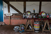 The aftermath debris of glasses and beer kegs, the morning after a 50th birthday party, in a barn in the Herefordshire countryside, on 23rd June 2019, in Kington, herefordshire, England.