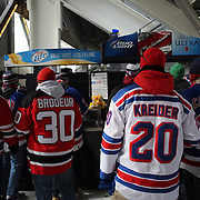 Fans queue for beer at Yankee Stadium during the New York Rangers Vs New Jersey Devils NHL regular season game held outdoors at Yankee Stadium, The Bronx, New York, USA. 26th January 2014. Photo Tim Clayton