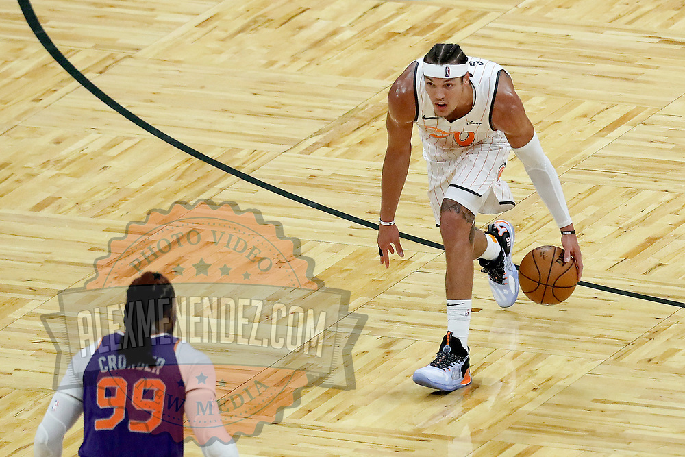 ORLANDO, FL - MARCH 24: Aaron Gordon #00 of the Orlando Magic dribbles the ball against Jae Crowder #99 of the Phoenix Suns at Amway Center on March 24, 2021 in Orlando, Florida. NOTE TO USER: User expressly acknowledges and agrees that, by downloading and or using this photograph, User is consenting to the terms and conditions of the Getty Images License Agreement. (Photo by Alex Menendez/Getty Images)*** Local Caption *** Aaron Gordon; Jae Crowder