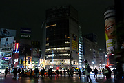 Darkened Shibuya, due to power saving after a magnitude 9 earthquake and large tsunami hit the Tohoku region of north east Japan  on March 11th killing nearly 20,000 people and causing massive destruction along the whole coast, and a melt-down at the Fukushima Daichi nuclear power station. Shibuya, Tokyo, Japan March 15th 2011