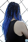 male person with blue dreadlocks embedded in his natural hair