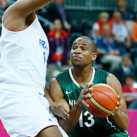 06 August 2012: Nigeria Derrick Obasohan drives past France Boris Diaw during 79-73 Team France victory over Team Nigeria, during the men's basketball preliminary, at the Basketball Arena, in London, Great Britain.