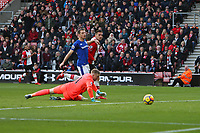 Football - 2017 / 2018 Premier League - Southampton vs. Everton<br /> <br /> Southampton's Dusan Tadic rolls the ball past Jordan Pickford of Everton to open the scoring at St Mary's Stadium Southampton<br /> <br /> COLORSPORT/SHAUN BOGGUST