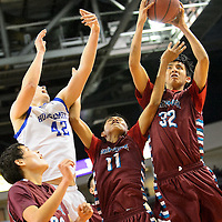 031214  Adron Gardner/Independent<br /> <br /> Shiprock Chieftain Ryan Benally (32) grabs a rebound during the state high school basketball tournament at the Santa Ana Star Center in Rio Rancho Tuesday.