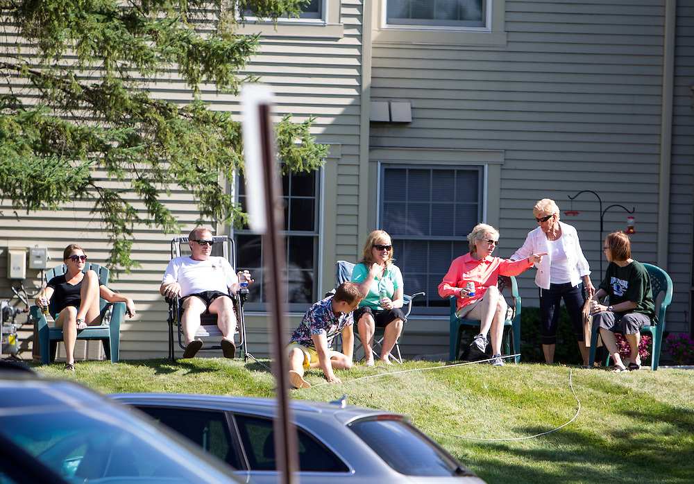 Neighbors set up chairs to watch the protest at the dental office of lion hunter Walter James Palmer in Bloomington, MN, July 29, 2015.