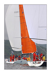Yachting- The last days racing  of the Bell Lawrie Scottish series 2003 at Tarbert Loch Fyne.  Damp grey skies and light winds decided the final results in most fleets...Hamish McKay and crew in their chartered Kerr 11.3 Blue Bell in Class one close to Azure a Dubois 40...Pics Marc Turner / PFM