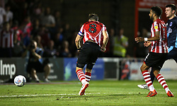 Lincoln City's Lee Frecklington scores his side's second goal of the game
