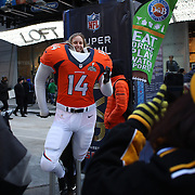 Fans pose for photographs with a life size NFL figure during Super Bowl week activities in Times Square, New York, USA. 29th January 2014. Photo Tim Clayton