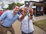 17 AUGUST 2019 - DES MOINES, IOWA: Representative SETH MOULTON (D-MA), left, poses for a selfie at the Iowa State Fair Saturday.  Moulton, a US Marine veteran who served in Iraq, is running to be the Democratic candidate for the US Presidency in 2020 and spent Saturday campaigning at the fair. Iowa traditionally hosts the the first selection event of the presidential election cycle. The Iowa Caucuses will be on Feb. 3, 2020.         PHOTO BY JACK KURTZ