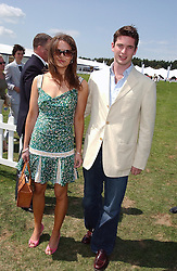 MISS ARABELLA MUSGRAVE and the HON.JAMES TOLLEMACHE at the 2004 Cartier International polo day at Guards Polo Club, Windsor Great Park, Berkshire on 25th July 2004.