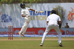 July 27, 2017 - Galle, Sri Lanka - Indian cricketer Wriddhiman Saha(L) reacts as he leaves a  bouncer ball  during  the 2nd Day's play in the 1st Test match between Sri Lanka and India at the Galle International cricket stadium, Galle, Sri Lanka on Thursday 27 July 2017. (Credit Image: © Tharaka Basnayaka/NurPhoto via ZUMA Press)