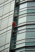 CHANGSHA, CHINA - SEPTEMBER 15: (CHINA OUT) <br /> <br /> Man Climbs On Glass Wall In Changsha<br /> <br /> 24 - year - old Austrian climber Michael Kemeter climbs the tallest skyscraper of Changsha on September 15, 2013 in Changsha, Hunan Province of China. It took Michael one hour to climb from the ground to the 45th floor, reaching a height of about 200 meters, without any protective measures. <br /> ©Exclusivepix