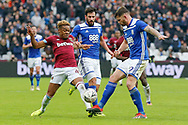 West Ham United midfielder Grady Diangana challenged by Birmingham City defender Harlee Dean (12) during the The FA Cup 3rd round match between West Ham United and Birmingham City at the London Stadium, London, England on 5 January 2019.