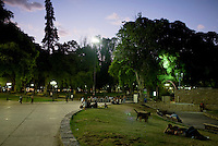 Mendicinos relax and visit in the Plaza Independencia at dusk in central Mendoza, Argentina.