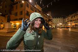 Ela Dutch in the square after a great dinner at the 12 Apostles Restaurant (in continuous operation with the same name for almost 300 years) during Motor Bike Expo. Verona, Italy. January 23, 2016.  Photography ©2016 Michael Lichter.