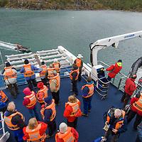 Crew of Chilean cruise ship Mare Australis loads zodiac rafts in Wulaia Bay, near Navarino Island, Tierra del Fuego, Chile.