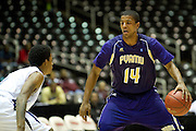 Carl Blair (14) of Prairie View A&M brings the ball up the court against Jackson State during the SWAC semi-finals at the Curtis Culwell Center in Garland on Friday, March 15, 2013. (Cooper Neill/The Dallas Morning News)