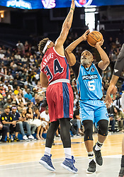 July 6, 2018 - Oakland, CA, U.S. - OAKLAND, CA - JULY 06: David Hawkins (34) of Tri-State sets up a block on the shot by Cuttino Mobley (5) co-captain of Power during game 3 in week three of the BIG3 3-on-3 basketball league on Friday, July 6, 2018 at the Oracle Arena in Oakland, CA (Photo by Douglas Stringer/Icon Sportswire) (Credit Image: © Douglas Stringer/Icon SMI via ZUMA Press)
