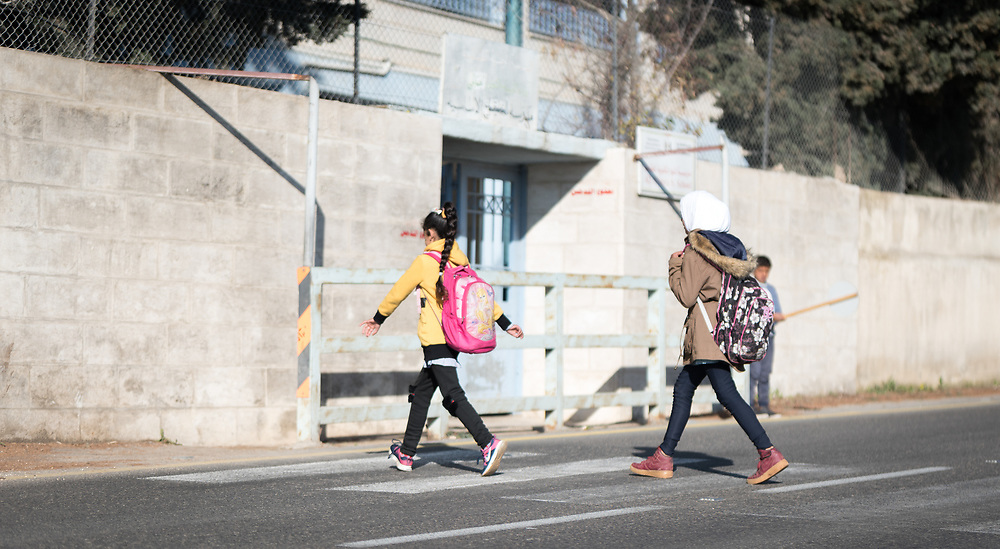 18 March 2019, Bethlehem, Occupied Palestinian Territories: A group of children head to Al Minya school. Ecumenical Accompaniers from the World Council of Churches' Ecumenical Accompaniment Programme in Palestine and Israel spend the morning doing a 'school run', by which they offer a peaceful protective presence for Palestinian children as they go to school at Al Minya.  With Israeli settler communities nearby, strong military presence, and a high-speed road passing just by the school entrance, an international presence can help ensure safe passage for the children.