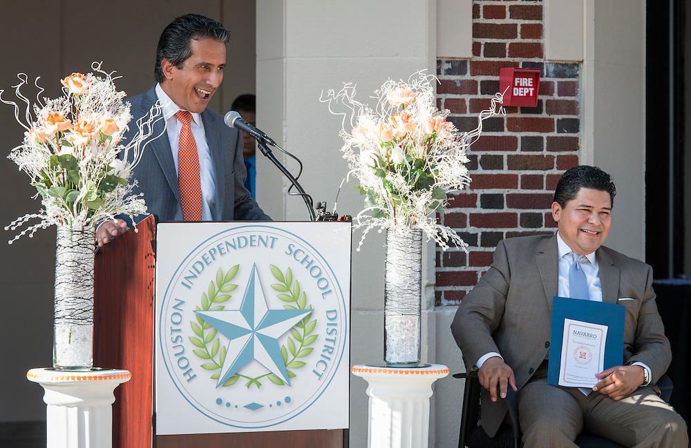 Houston ISD superintendent Richard Carranza listens as Christian Navarro comments during a ceremony to rename Jackson Middle School to Navarro Middle School in honor of Yolanda Black Navarro, October 5, 2016.