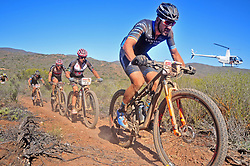 ROBERTSON, SOUTH AFRICA - MARCH 20: From fornt Alban Lakata, Howard Grotts, Jaroslav Kulhavy and Kristien Hynek lead riders up a singletrack climb during stage two's 110km from Robertson on March 20, 2018 in Cape Town, South Africa. Mountain bikers from across South Africa and internationally gather to compete in the 2018 ABSA Cape Epic, racing 8 days and 658km across the Western Cape with an accumulated 13 530m of climbing ascent, often referred to as the 'untamed race' the Cape Epic is said to be the toughest mountain bike event in the world. (Photo by Dino Lloyd)