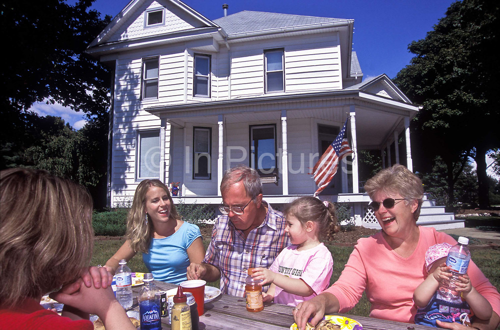 A family have lunch on their front lawn in America's Corn belt state of Illinois, USA.