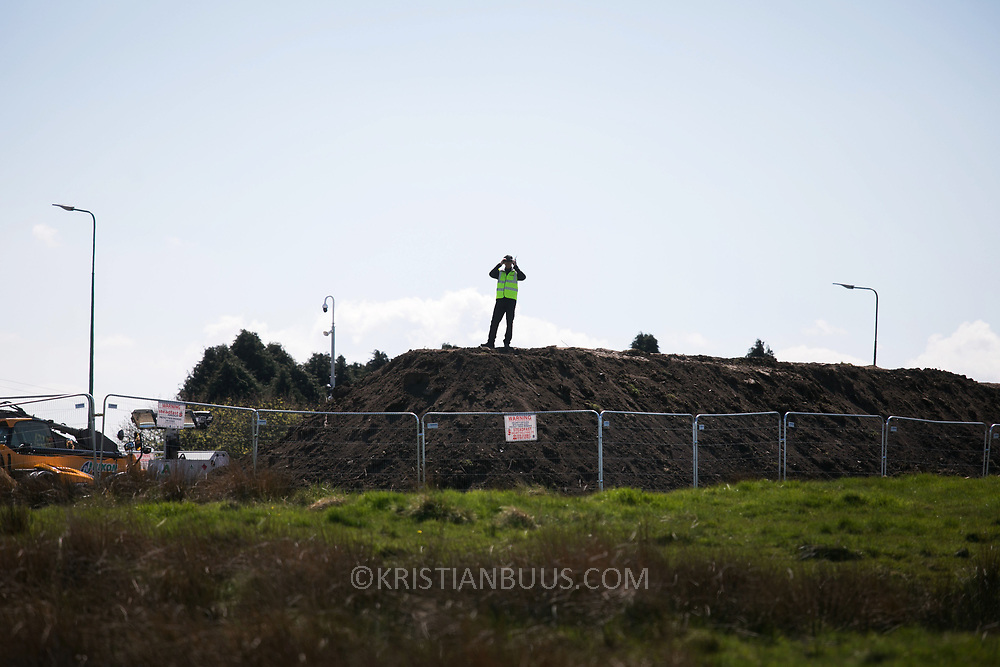 Security guard protecting the building site of the mine inPont Valley.  Day of protest in Pont Valley 5 may 2018 against the extraction of coal by the mining company Banks outside Dipton in Pont Valley, County Durham. Locals have fought the open cast coal mine for thirty years and three times the local council rejected planning permissions but central government has overruled that decision and the company Banks was granted the license and rights to extract coal in early 2018. Locals have teamed up with climate campaigners and together they try to prevent the mining from going ahead. The mining will have huge implications on the local environment and further coal extraction runs agains the Paris climate agreement. A rare species of crested newt live on the land planned for mining and protectors are trying to stop the mine to save the newt.