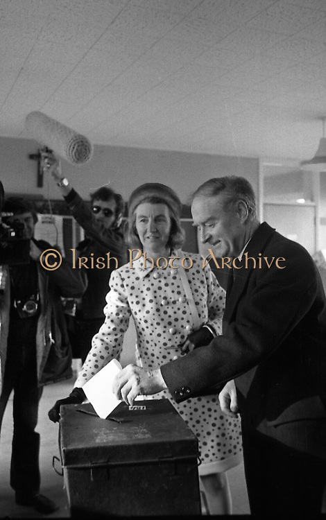 Liam Cosgrave Votes In General Election (E47).1973..28.02.1973..02.28.1973..28th February 1973..After sixteen consecutive years of Fianna Fail Government the Irish people went to the polls today to elect a new government. Mr Liam Cosgrave hoped that a coalition with Labour would oust the current office holders...Image of Mr and Mrs Cosgrave casting their votes in the polling station.