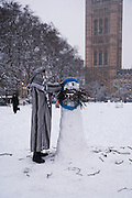 Weather, climate change. London, Britain and Europe, is gripped by a big freeze. Winter conditions which are likened to Siberia swept across Europe, bringing traffic and transport to a halt, closing schools and stopping millions of people going to work. Whilst most buses and tubes were not working, some commuters and tourists got to central London to enjoy the freak snow.///Abdullah, describing himself as a rational Muslim, prepares and videos his blog, a rational explication of Islam, with his snowman 'Osama bin snowman'