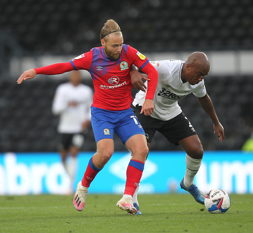 Blackburn Rovers' Harry Chapman in action with  Derby County's Andre Wisdom<br /> <br /> Photographer Mick Walker/CameraSport<br /> <br /> The EFL Sky Bet Championship - Derby County v Blackburn Rovers - Saturday 26th September 2020 - Pride Park Stadium - Derby <br /> <br /> World Copyright © 2020 CameraSport. All rights reserved. 43 Linden Ave. Countesthorpe. Leicester. England. LE8 5PG - Tel: +44 (0) 116 277 4147 - admin@camerasport.com - www.camerasport.com