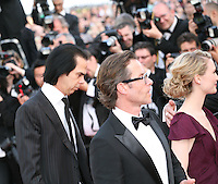 Nick Cave, Guy Pearce, Mia Wasikowska attend the gala screening of Lawless at the 65th Cannes Film Festival. The screenplay for the film Lawless was written by Nick Cave and Directed by John Hillcoat. Saturday 19th May 2012 in Cannes Film Festival, France.