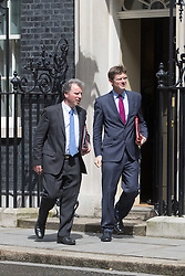 Downing Street,  London, June 27th 2015. Chancellor of the Duchy of Lancaster and Policy Advisor Oliver Letwin (Left) and Communities Secretary Greg Clark leave the first post-Brexit cabinet meeting at 10 Downing Street.