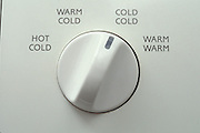 detail of washing machine knob set to cold cold