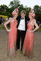 Left to right, MARY POWYS, MARK SHAND and RUTH POWYS CEO of Elephant Family at The Animal Ball in aid of The Elephant Family held at Lancaster House, London on 9th July 2013.