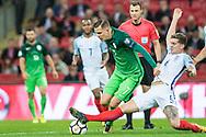 England (6) John Stones, Slovenia (7)Josip Iličić during the FIFA World Cup Qualifier match between England and Slovenia at Wembley Stadium, London, England on 5 October 2017. Photo by Sebastian Frej.