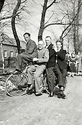 having fun posing with four on a bicycle rural Holland 1940s