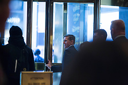 Retired United States Army lieutenant general, Mike Flynn leaves Trump Tower in Manhattan, New York, U.S., on Friday, November 18, 2016. POOL PHOTO BY John Taggart/Bloomberg