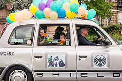 Pictured: <br /> <br /> There were np prisoners taken when the Edinburgh Taxi Drivers annual charity trip headin g towards Princes Street with Transport minister Humza Yousaf and policeman making great targets for the water bombs and water pistols carried by the young passengers.<br /> <br /> Ger Harley | EEm 13 June 2017