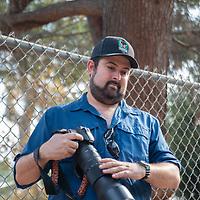 Science writer Dr. Jason Goldman looks for urban raptors in Grioffith Park, Los Angeles, CA.