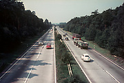 A 1960s aerial view from a bridge, of a German autobahn carrying VW Beetles, a Mercedes and trucks, in 1968, in North Rhine-Westfalia, Germany. (Photo by Richard Baker / In Pictures via Getty Images)