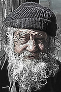 Portrait of the weather face of an old sailor.
