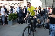 Cyclist giving his puppy a ride in the back of his trailer along the South Bank in London, England, United Kingdom. The South Bank is a significant arts and entertainment district, and home to an endless list of activities for Londoners, visitors and tourists alike.