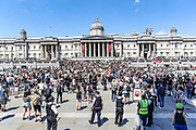 People, some of them kneeling gather in Trafalgar Square in central London on Sunday, May 31, 2020 to protest against the recent killing of George Floyd by police officers in Minneapolis that has led to protests across the US. (Photo/ Vudi Xhymshiti)