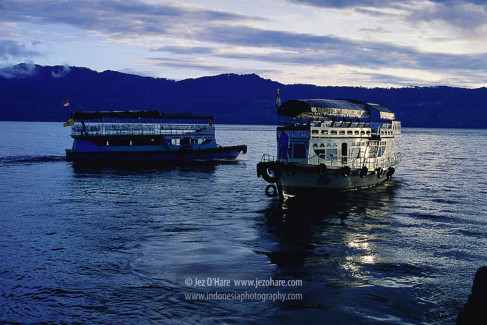 Ferries crossing Lake Toba between Prapat & Tuk Tuk, North Sumatra, Indonesia.